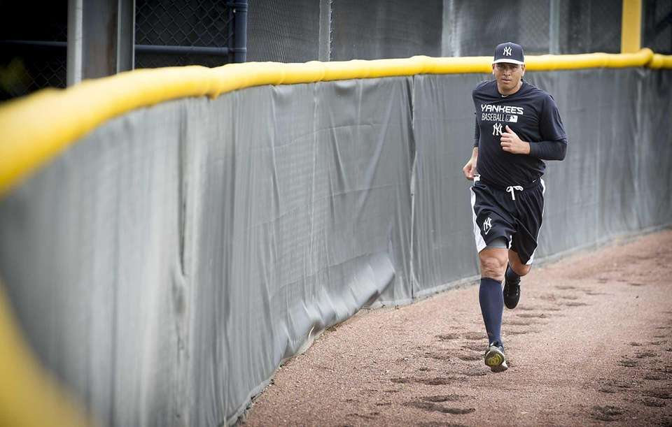 The Yankees' Alex Rodriguez runs wind sprints after