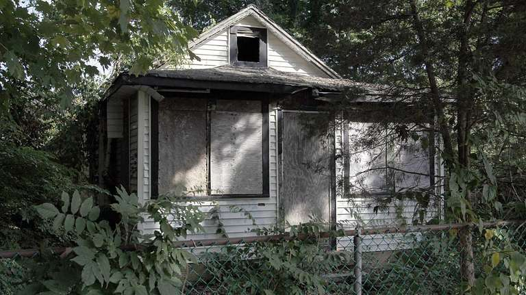 An abandoned house in Mastic shown on Friday,