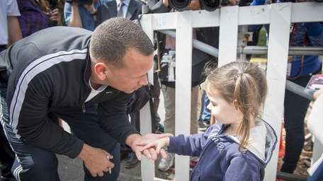 The Yankees' Alex Rodriguez gets a hand from