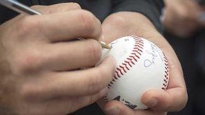 The Yankees' Alex Rodriguez signs autographs for fans