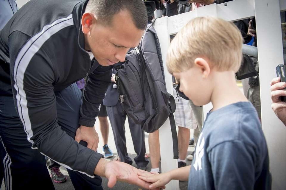 The Yankees' Alex Rodriguez gets a fist-bump from