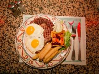 Ribeye steak and eggs is served at the