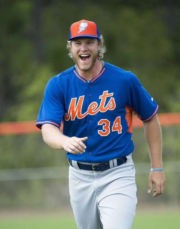 New York Mets pitcher Noah Syndergaard laughs during