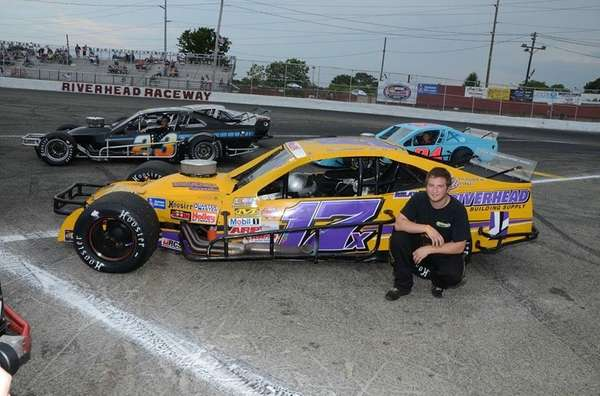 Kyle Ellwood poses with his NASCAR Whelen Modified