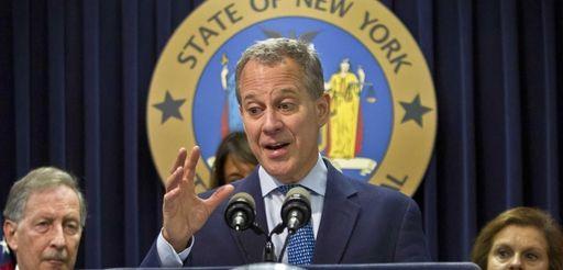 New York Attorney General Eric Schneiderman, center, speaks