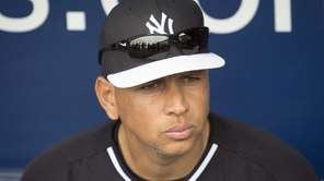 New York Yankees third baseman Alex Rodriguez sits
