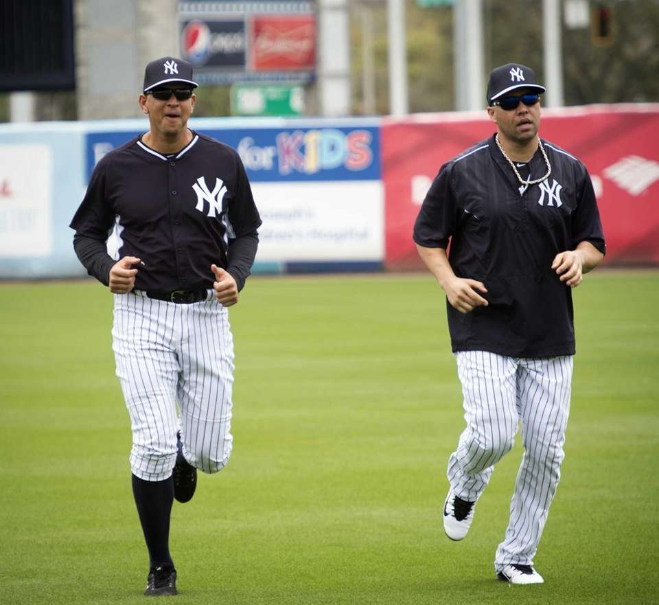 New York Yankees third baseman Alex Rodriguez, left,