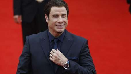 John Travolta arrives at the opening ceremony of