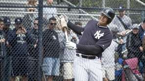 Yankees third baseman Alex Rodriguez loosens up before