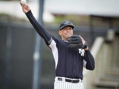 Yankees third baseman Alex Rodriguez fields ground balls
