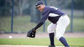 Yankees third baseman Alex Rodriguez fields ground balls