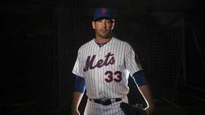 Mets pitcher Matt Harvey looks on during photo