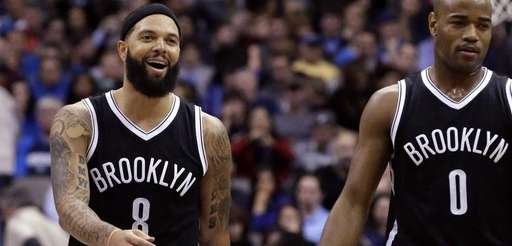 Brooklyn Nets' Deron Williams walks with teammate Jarrett