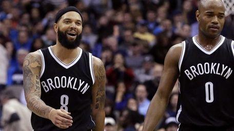 Brooklyn Nets' Deron Williams walks with teammate Jarrett
