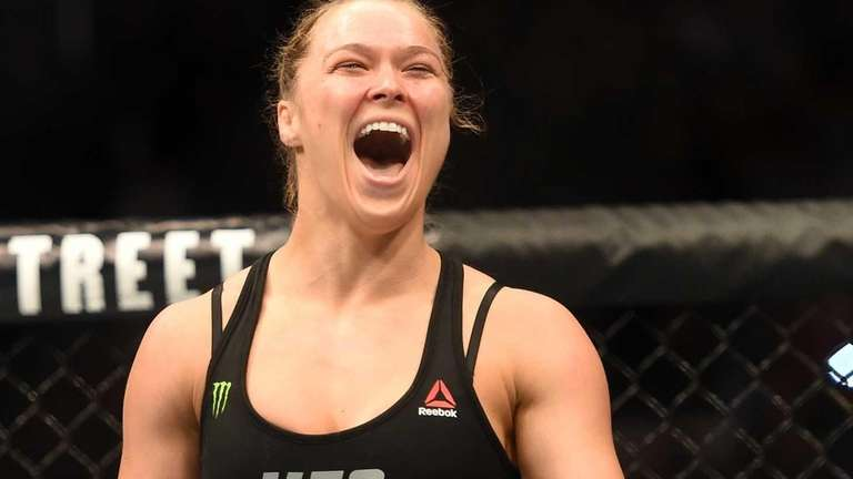 Ronda Rousey celebrates her victory over Cat Zingano