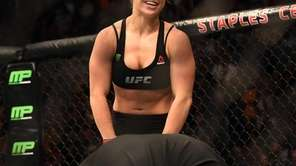 Ronda Rousey celebrates her victory over Cat Zingano