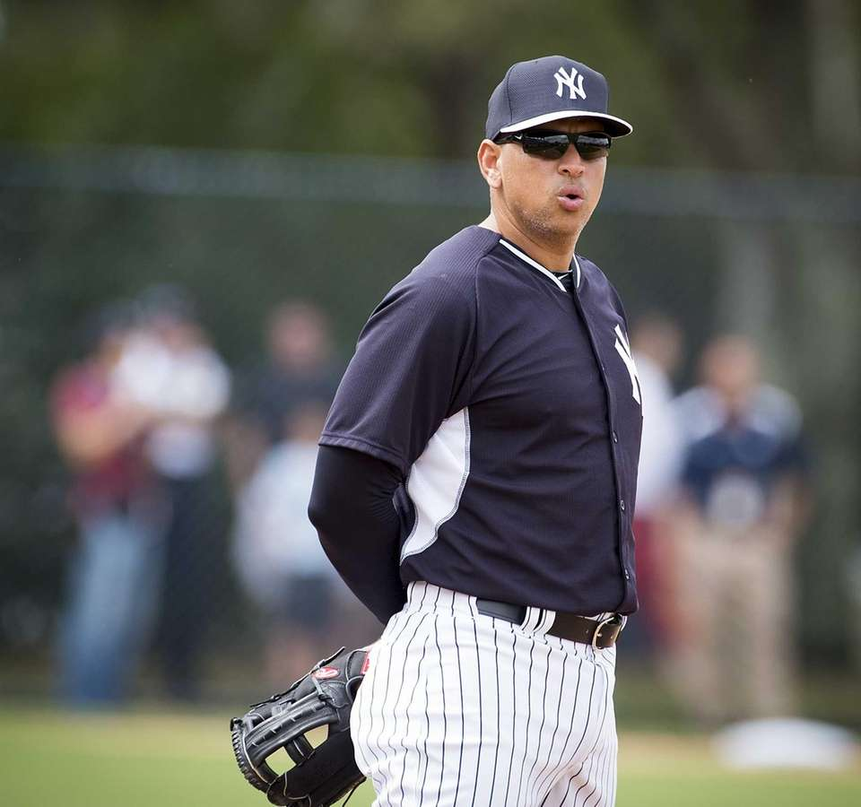 New York Yankees' Alex Rodriguez looks on during