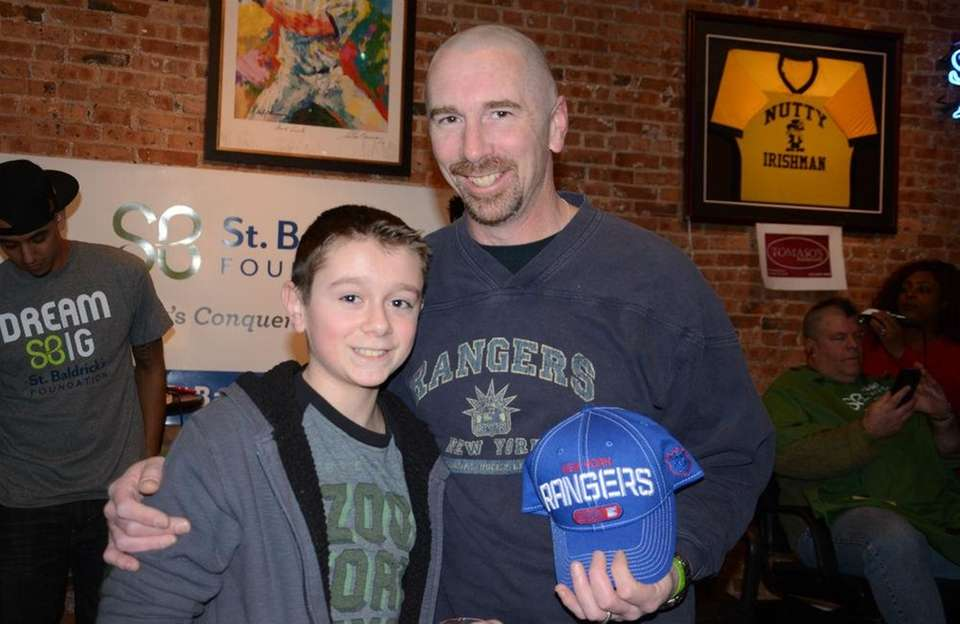 From left, West Islip's Jason Fisher, 13, a