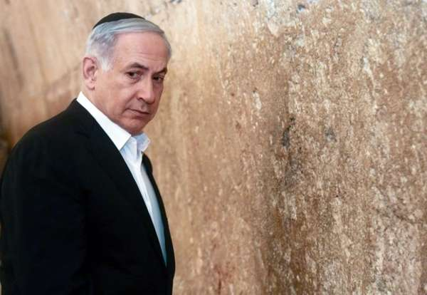 Israeli Prime Minister Benjamin Netanyahu looks on before