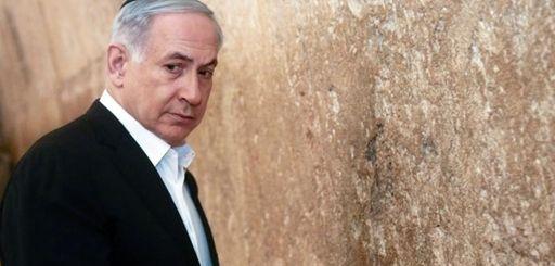 Israeli Prime Minister Benjamin Netanyahu looks on before