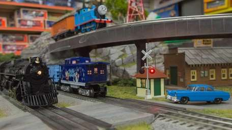 Diesel locomotives pass through the crossing lights on